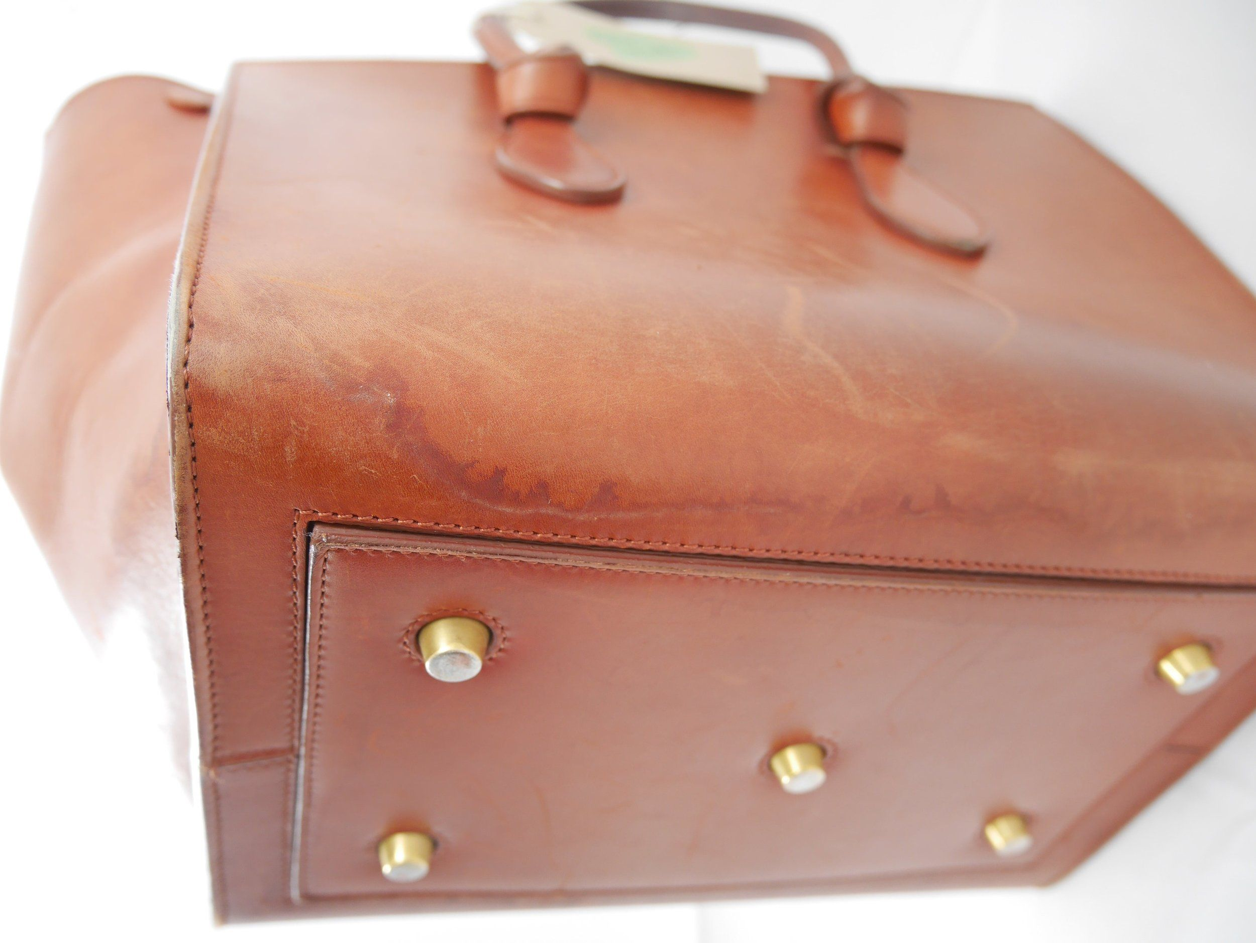 Before: visible watermarks on leather exterior