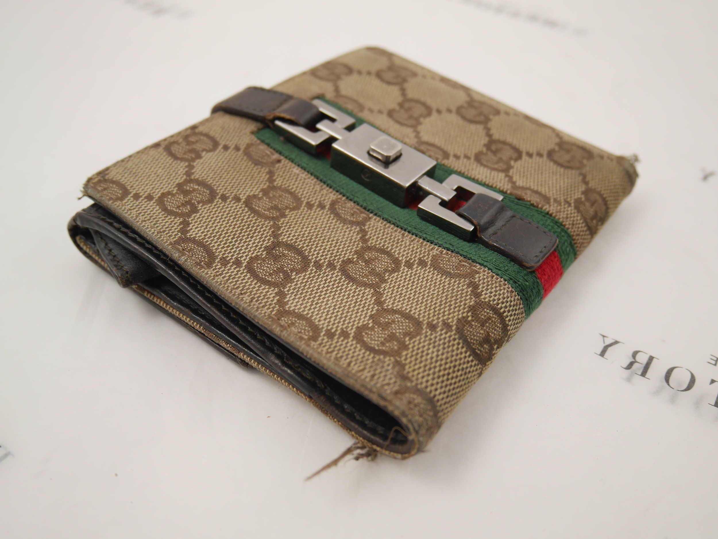 Before: frayed corners on the Gucci wallet