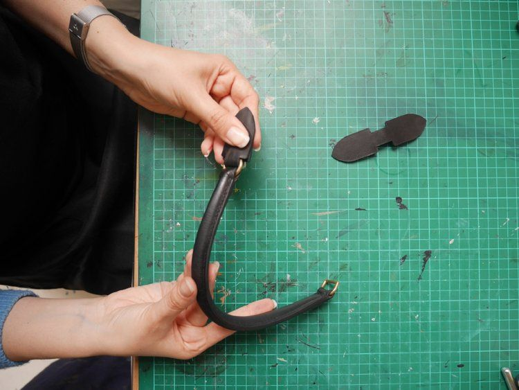 Attaching the leather tabs to the handle