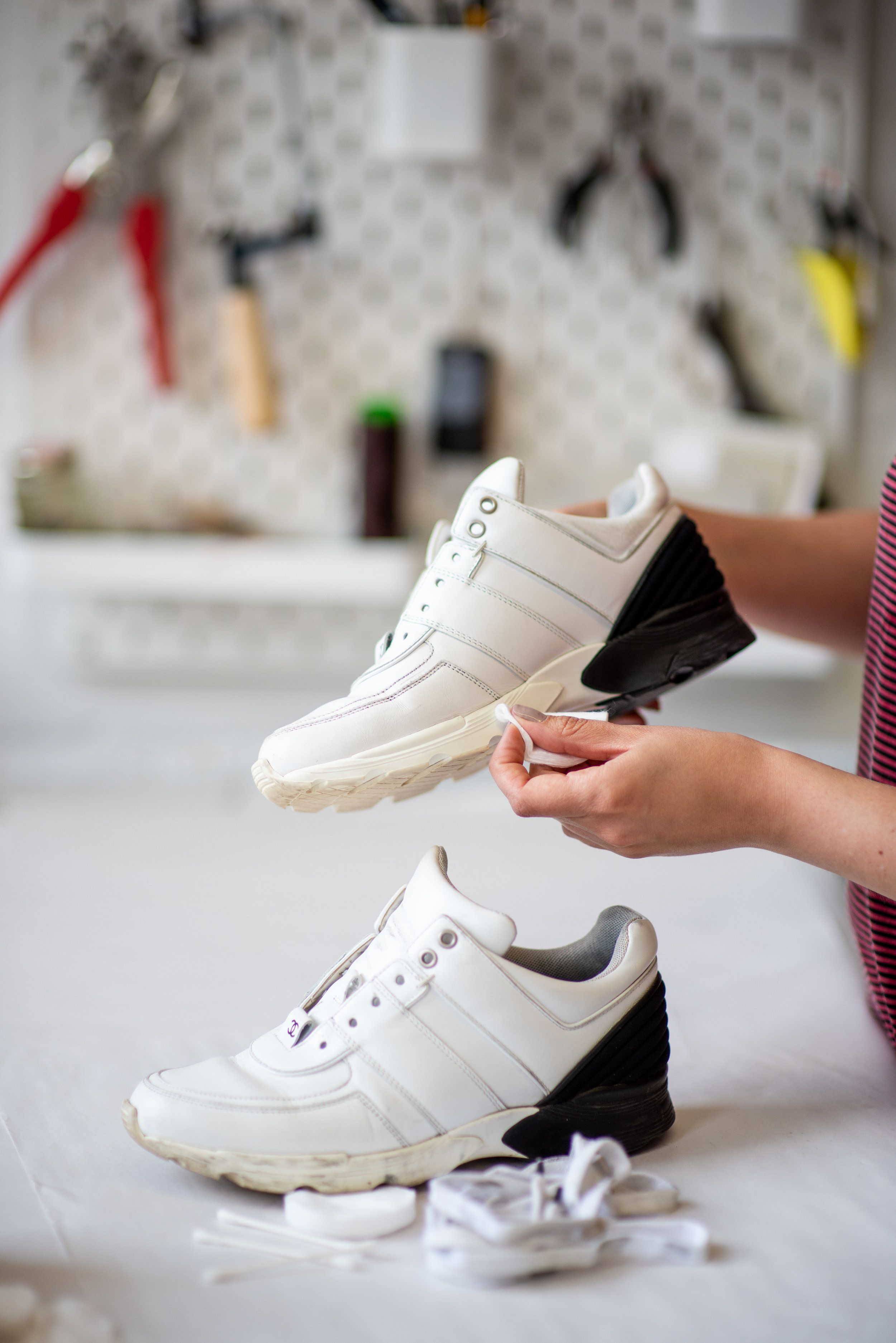 Cleaning Chanel sneakers at The Restory atelier