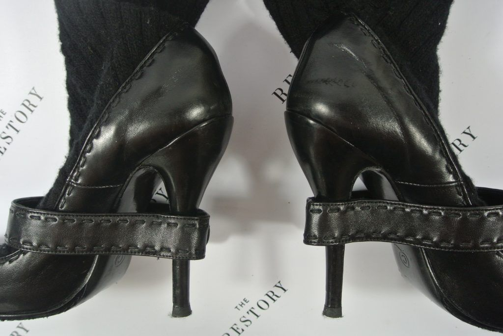 Scuffs to the heels, worn down heel tips